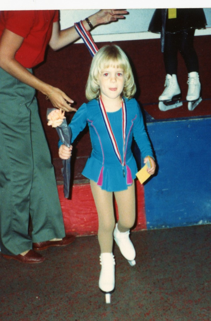 Melissa (Taylor) Duncan getting a medal after skating